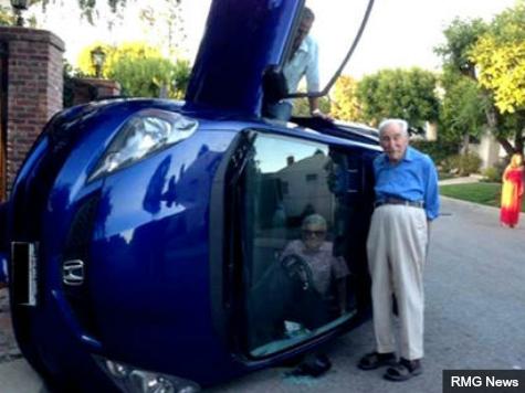 Elderly Couple Flip Honda, Take Selfie