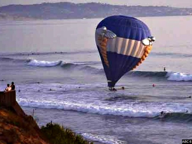 Couple's Proposal on Hot Air Balloon Ends in Surfer Rescue