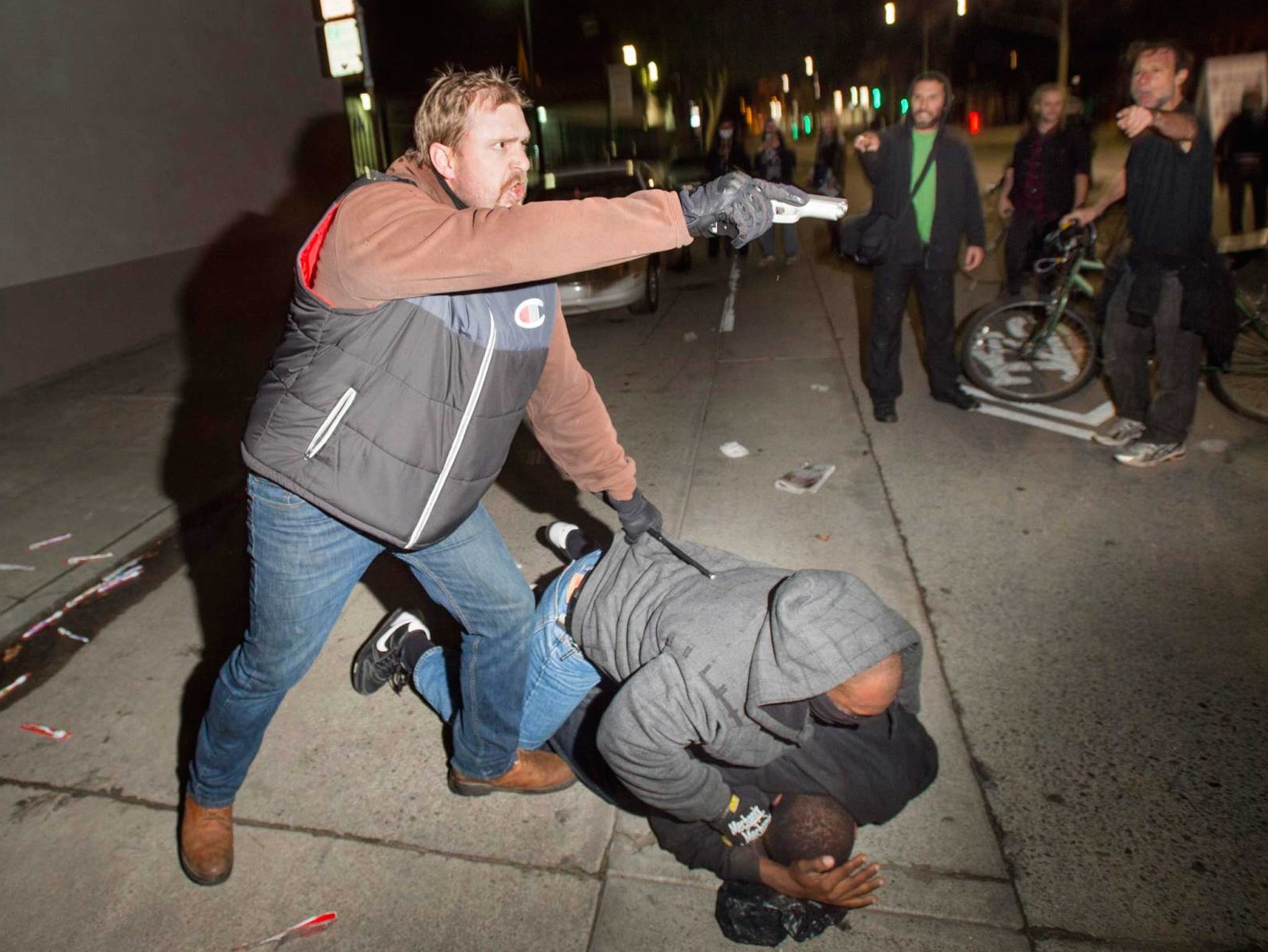 Undercover Officer Draws Gun on Oakland Protesters After Being Attacked