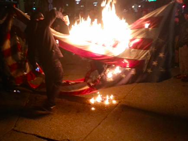 Flags Burnt, Stores Smashed–and 'Peaceful Protest'–as CA Joins Millions March