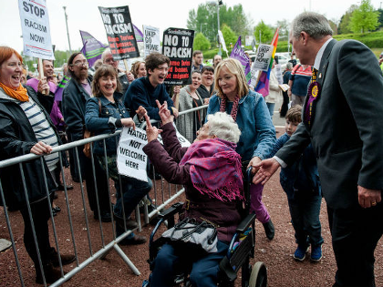 PICTURED: Wheelchair-bound UKIP Woman Flicks Two Fingers to Hard Left Protesters