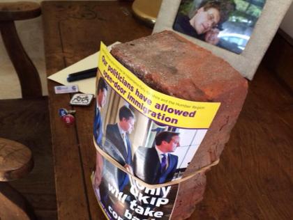 Brick Thrown Through UKIP MEP's Window, Farage Under Threat