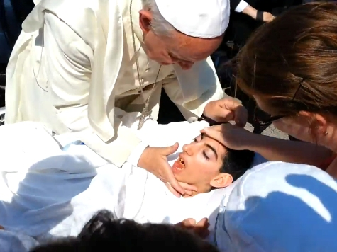 WATCH: Pope Francis Stops Car to Bless Disabled Woman
