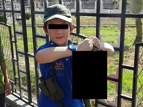 Seven-Year-Old Jihadi Poses with Severed Head