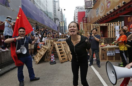 Hong Kong Protesters to Vote on Staying in Streets