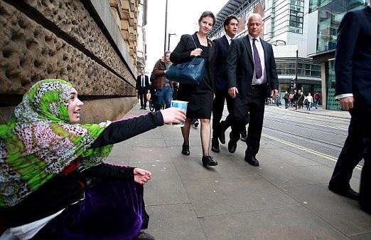 Miliband Slammed over 'Pathetic, Bleeding-Heart' Photo Opportunity with Beggar