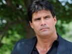 Jose Canseco Blows Off Middle Finger while Cleaning Gun