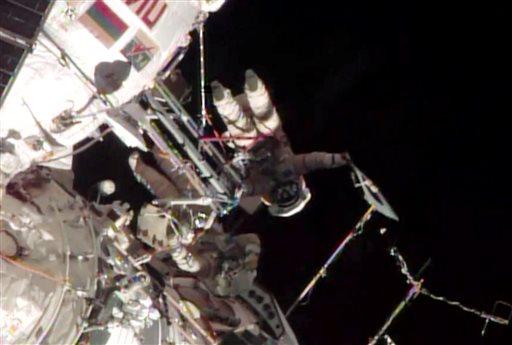 Olympic Torch Taken on First Spacewalk
