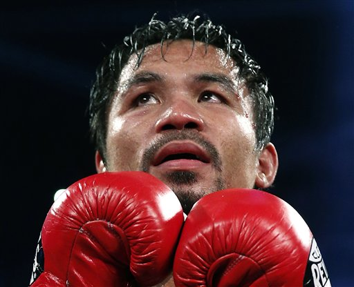 Report: Pacquiao Borrowed Money to Give Typhoon Aid Because of Tax Dispute