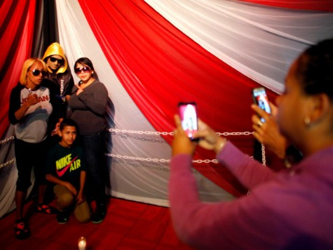 Family Props Up, Poses with Dead Boxer in Boxing Ring at Wake
