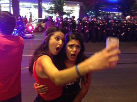 Arizona Students Take Selfies During Riot