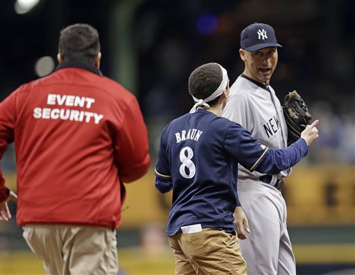 Brewers Fan Charges Derek Jeter on Field
