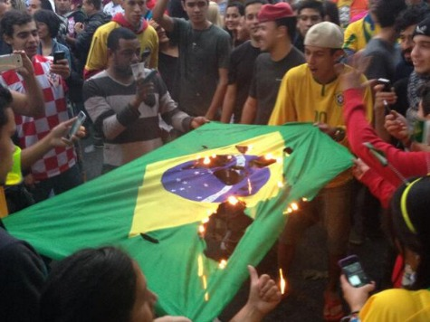 Hometown Fans Burn Brazilian Flags During World Cup Shellacking