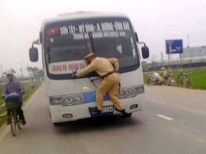 Hanoi Cop Gets Wild Ride On Front Of Bus