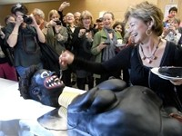 Shock Video: Swedish Politician Eating From Screaming 'African Corpse Cake'
