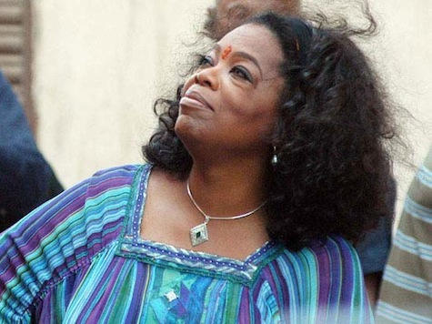 Oprah Surprised As She Visits Slums In India