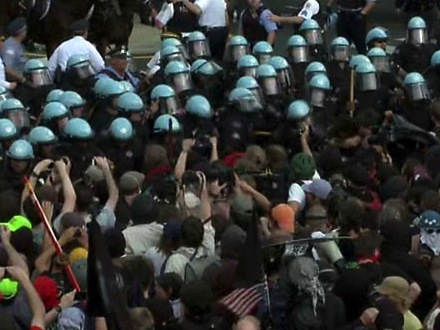 Report: NATO Protesters Douse Cops With Urine