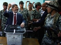 Morsi: Abroad Women Are 'Free,' But Not Here