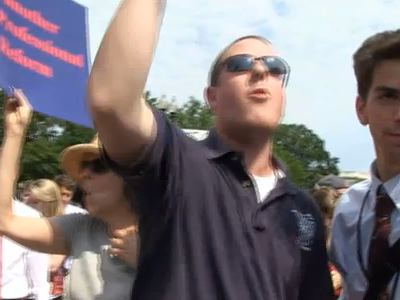 Protester Celebrates Obamacare Ruling By Screaming 'F*** You, Mitt Romney' Outside The Supreme Court