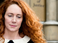 Eight Charged With Phone-Hacking In Britain
