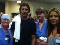 Christian Bale Visits with Movie Massacre Victims