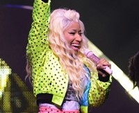 Crazed fan grabs Nicky Minaj on stage in Miami