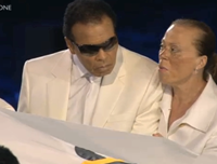 Muhammad Ali Accompanies Olympic Flag