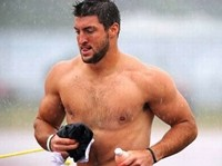 Big News: Shirtless Tebow Runs Off Practice Field