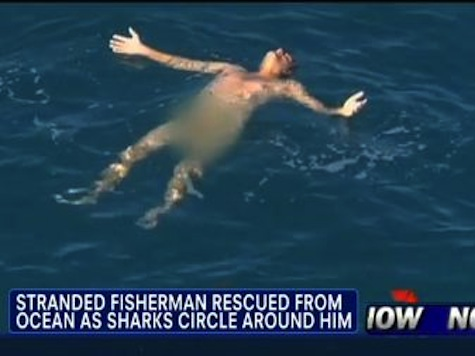 Caught on Tape: Naked Fisherman Rescued As Sharks Circle Around Him