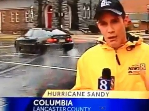Car Powerslides into Journalist's Sandy Report