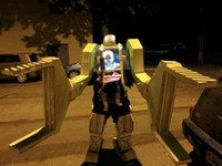 Dad, Baby Dress as Power Loader from 'Aliens' for Halloween