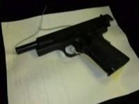 Loaded Semi-Automatic Handgun Found In Case of Frozen Meat