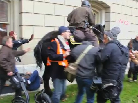 Mounted Police Use Horses To Control Near Rioting Michigan Union Protesters