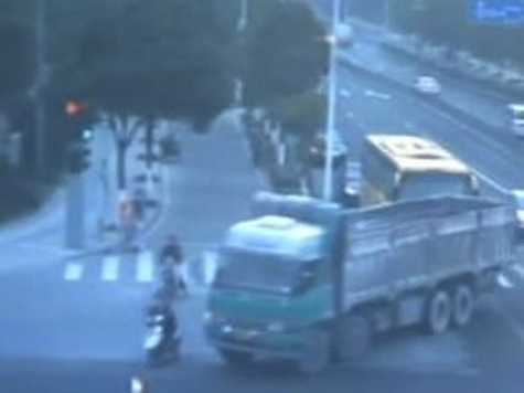 Amazing: Woman on Scooter Run Over By Truck And Walks Away