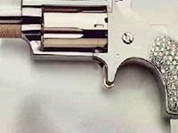 Kim Kardashian Causes Outrage After Posting Diamond Gun Pic