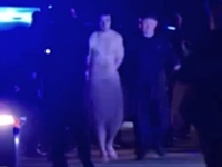 Naked Suspect Arrested, Thrown in Cop Car