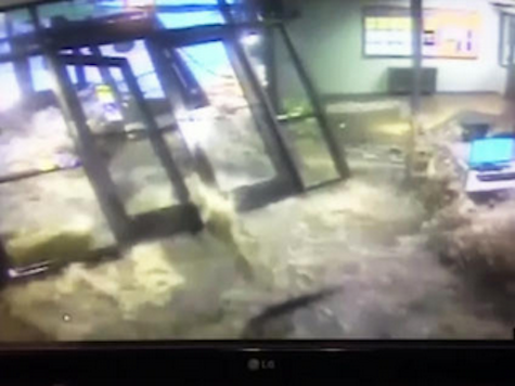 WATCH: Floodwater Breaks Through College Campus Doors
