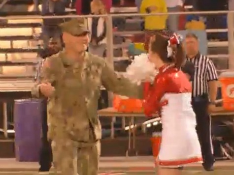 WATCH: High School Cheerleader Gets Surprise Reunion with Navy Dad