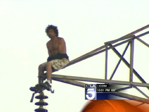 Shirtless Man Stuck on Transmission Tower for Four Hours