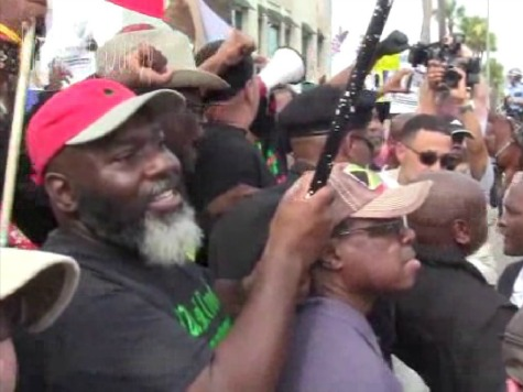 New Black Panthers Try to Cross Road Toward Counter-Demonstrators