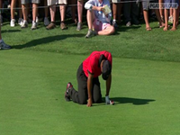 Tiger Woods Drops To Knees From Back Spasm