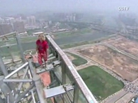 Man Climbs 900-Foot Building, Jumps Off
