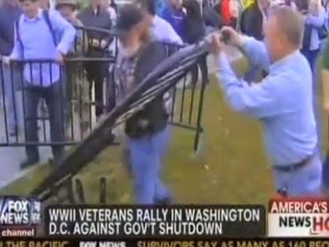 Veterans Take Down Barriers from WWII Memorial