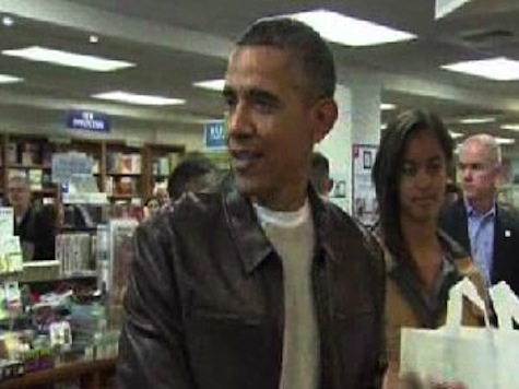 Obama Shops At DC Bookstore To Cheering Crowd