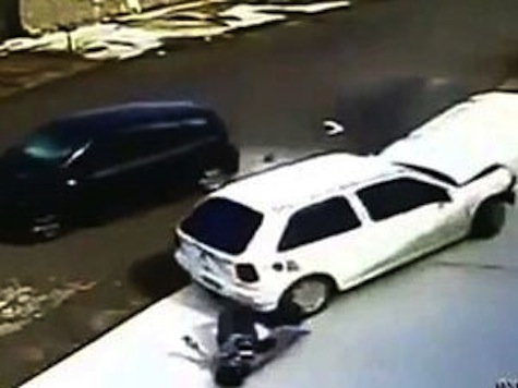 Unbelievable Video: Small Child and Grandmother Survive Being Run Over by Crashing Car