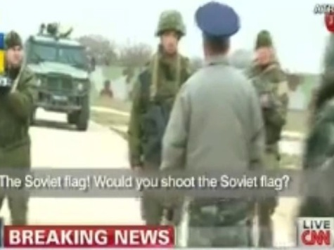 Tense Exchange Between Russian Soldiers 'Following Orders' and Unarmed Ukrainians Caught on Tape