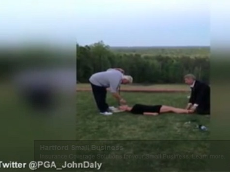 John Daly Hits Golf Ball Off Tee in Model's Mouth