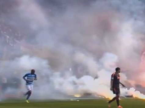 Soccer Match Halted After Fans Throw Flares on Field