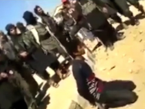 Watch: ISIS Boy Jihadis with Automatic Weapons Witnessing Execution