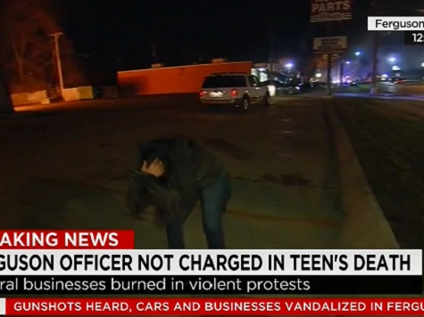 CNN Reporter Hit With Rock On Air